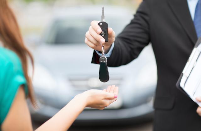 Handing over keys to car