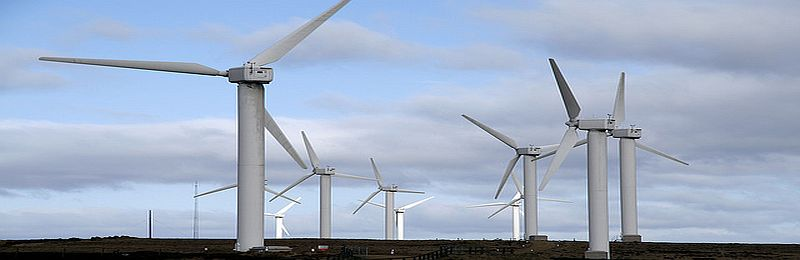 wind turbines - green taxes on energy bills have nearly doubled