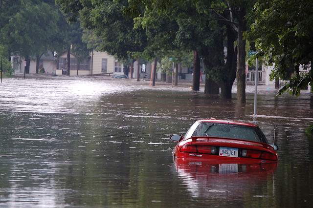 Flooded street and car