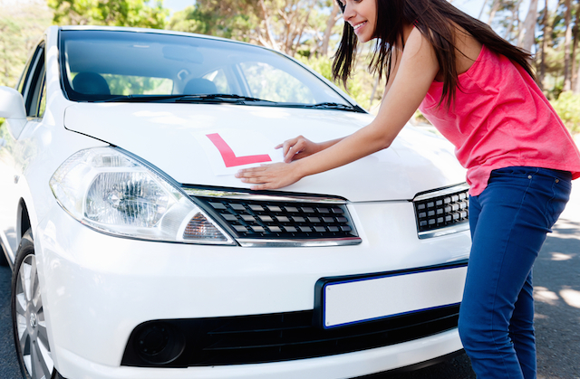 driving theory test costs - young woman getting ready for her driving test