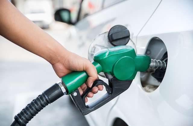 petrol pump pumping gas to a fuel efficient car