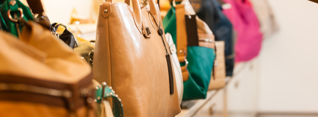 Row of handbags in department store on sale, discounted with a store credit card